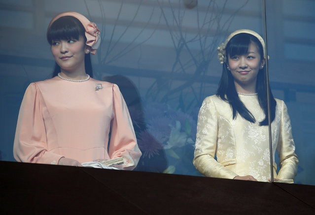 Japan's Princess Mako (L) and Princess Kako, daughters of Prince Akishino and his wife Princess Kiko appear before well-wishers as they celebrate Emperor Akihito's 83rd birthday at the Imperial Palace in Tokyo,  Japan, December 23, 2016. (Photo by Issei Kato/Reuters)