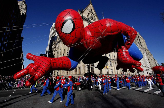 The Spiderman balloon floats down Central Park West during the 87th Macy's Thanksgiving Day Parade. (Photo by Gary Hershorn/Reuters)