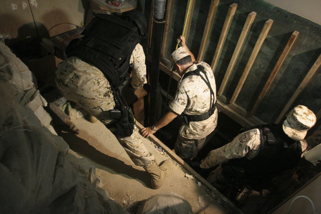 Soldiers inspect the entrance of a cross border tunnel at a warehouse in Tijuana, July 12, 2012. (Photo by Jorge Duenes/Reuters)