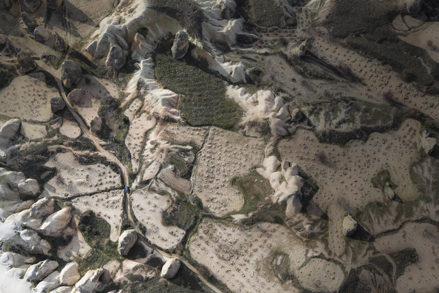 """""""Capadocia"""". An aerial view of a car pass by the rock formation area of Capadocia. Photo location: Capadocia, Turkey. (Photo and caption by Jeffry Lim/National Geographic Photo Contest)"""