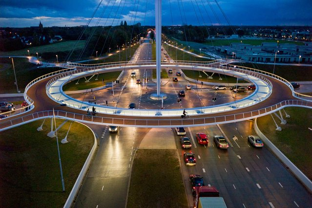 To address traffic congestion, a city in the Netherlands called Einhoven is using circular logic. An elevated 360-degree circuit, suspended by cables and stabilized by counterweights, is helping 5,000 bicyclists a day bypass roads used by 25,000 cars. The result? A bottleneck reduction for all. (Photo by Chris Keulen/National Geographic)