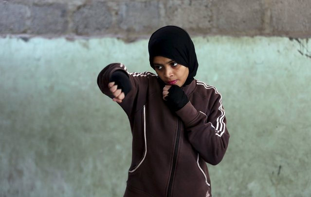 Misbah, 17, takes part in warm up exercises at the first women's boxing coaching camp in Karachi, Pakistan February 19, 2016. (Photo by Akhtar Soomro/Reuters)