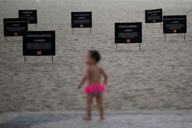 Signs that bear the names of children killed by stray bullets are seen during a protest calling for an end to the violence that erupts during police operations against suspected drug traffickers and thieves, at the Copacabana beach in Rio de Janeiro, Brazil, January 23, 2017. (Photo by Ueslei Marcelino/Reuters)