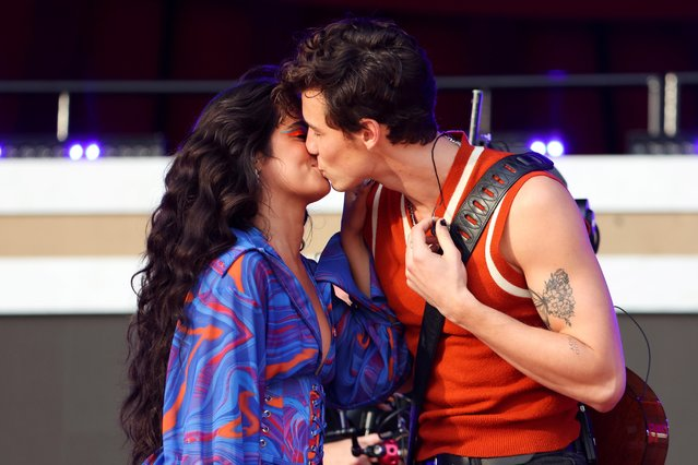 Singer Camila Cabello and Shawn Mendes kiss onstage at the 2021 Global Citizen Live concert at Central Park in New York, U.S., September 25, 2021. (Photo by Caitlin Ochs/Reuters)