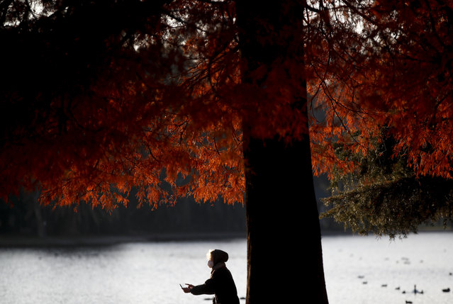 A woman takes pictures in a park amid the COVID-19 pandemic in Buenos Aires, Argentina, Wednesday, June 2, 2021. (Photo by Natacha Pisarenko/AP Photo)