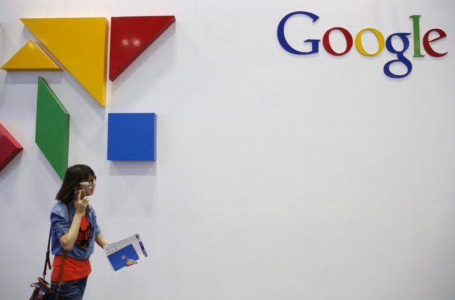 A woman walks past a logo of Google at the Global Mobile Internet Conference (GMIC) 2015 in Beijing, China, April 28, 2015. (Photo by Kim Kyung-Hoon/Reuters)