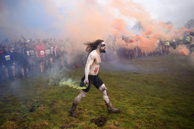 """Competitors prepare to start the """"Tough Guy"""" adventure race near Wolverhampton, central England, on January 29, 2017. (Photo by Oli Scarff/AFP Photo)"""