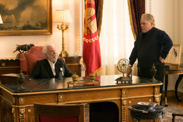 """""""The Hunger Games: Catching Fire"""", Donald Sutherland, Philip Seymour Hoffman, 2013. (Photo by Murray Close/Lionsgate/Everett Collection)"""