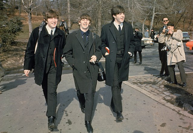 Three of the four Beatles, from left, John Lennon, Ringo Starr, and Paul McCartney, walk in Central Park in New York City, February 10, 1964 on their first U.S. tour. (Photo by AP Photo)