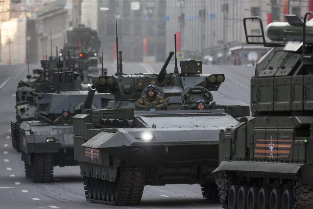 New Russian military vehicles make their way to Red Square during a rehearsal for the Victory Day military parade which will take place at Moscow's Red Square on May 9 to celebrate 70 years after the victory in WWII, in Moscow, Russia, Monday, May 4, 2015. The military parade takes place on Saturday, the 70th anniversary of the victory over Nazi Germany in World War II. (AP Photo/Alexander Zemlianichenko)
