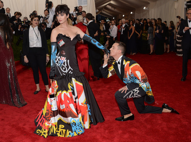 "Katy Perry and Jeremy Scott arrives at The Metropolitan Museum of Art's Costume Institute benefit gala celebrating ""China: Through the Looking Glass"" on Monday, May 4, 2015, in New York. (Photo by Evan Agostini/Invision/AP Photo)"