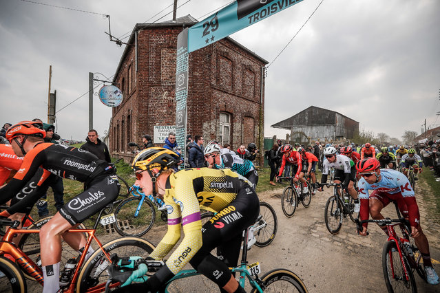 Riders of the Peloton approach a cobbled section near the Arenberg forrest at the 117th Paris-Roubaix cycle race in Wallers, France on April 12, 2019. (Photo by Christophe Petit-Tesson/EPA)