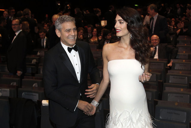 Actor George Clooney and Amal Clooney arrive at the 42nd Cesar Film Awards ceremony at Salle Pleyel in Paris, Friday, February 24, 2017. This annual ceremony is presented by the French Academy of Cinema Arts and Techniques. (Photo by Thibault Camus/AP Photo)