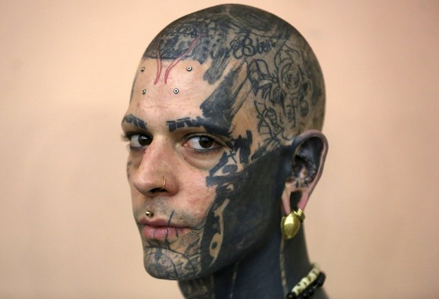 Tattoo artist Yank Brenyak poses for a portrait during the Great British Tattoo Show in Alexandra Palace in north London, Britain May 23, 2015. (Photo by Neil Hall/Reuters)