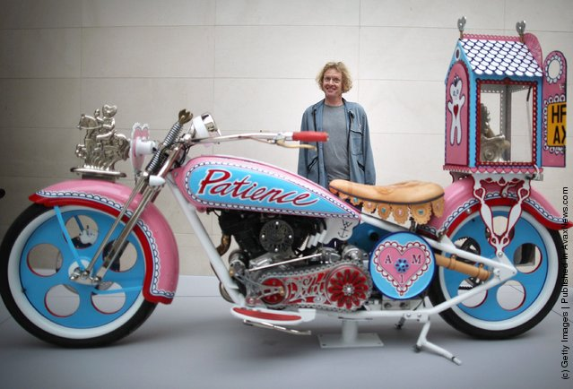 Grayson Perry stands with his 'Kenilworth AM1' customised motorbike