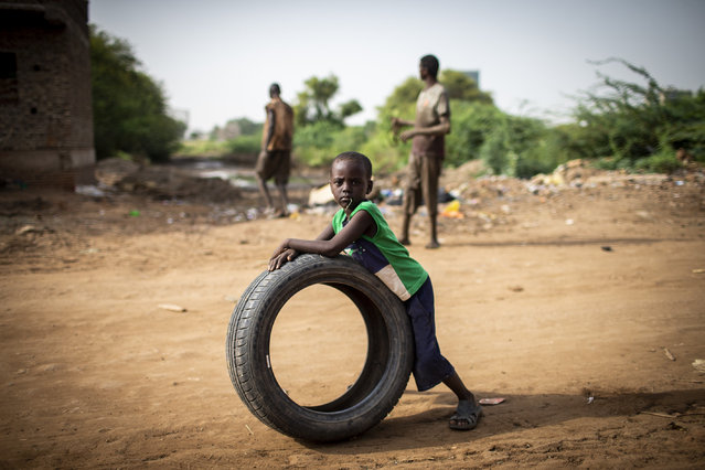 A Sudanese kid plays with a tire in Khartoum, Sudan on September 11, 2018. Sudan, situated in northern Africa and one of the largest country of the continent, has composition of different tribes, including Arabs, Fallata, Nuba, Beja tribes and other foreigners. (Photo by Ozge Elif Kizil/Anadolu Agency/Getty Images)