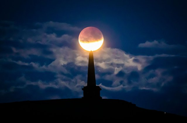 The partial lunar eclipse is visible above Stoodley Pike near Todmorden in West Yorkshire, England on July 16, 2019. (Photo by Danny Lawson/PA Images via Getty Images)