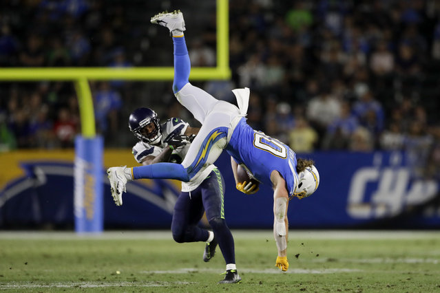 Los Angeles Chargers tight end Sean Culkin, right, is tackled by Seattle Seahawks cornerback Jamar Taylor during the second half of an NFL preseason football game Saturday, August 24, 2019, in Carson, Calif. (Photo by Gregory Bull/AP Photo)
