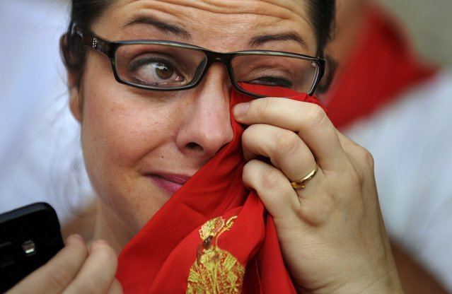 A woman cries during a procession in honour of San Fermin on the saint's day at the San Fermin festival in Pamplona, northern Spain, July 7, 2015. (Photo by Eloy Alonso/Reuters)