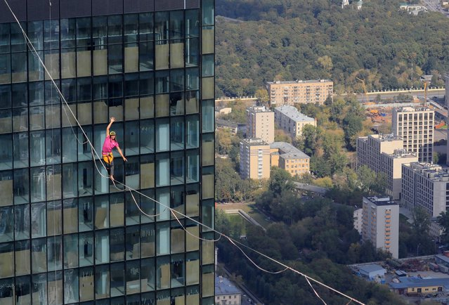 """A tightrope walker performs on a rope between skyscrapers of the Moscow International Business Centre, also known as """"Moskva-City"""", in Moscow, Russia September 7, 2019. (Photo by Tatyana Makeyeva/Reuters)"""