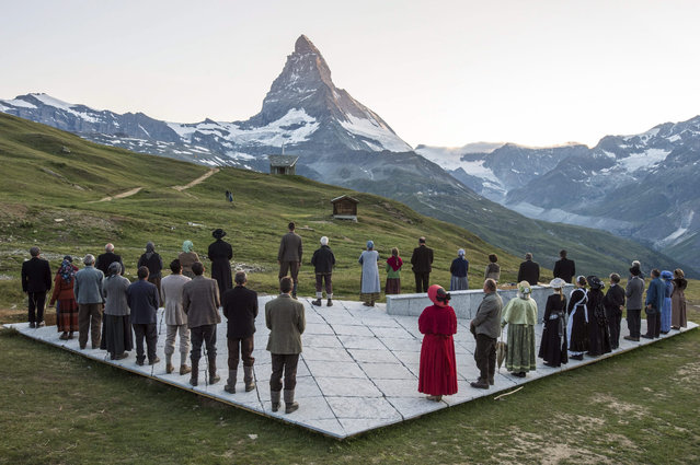 "Actors on stage during the premiere of the theater ""The Matterhorn Story"" which is based on the story of the first Matterhorn mountain ascent 150 years ago, in Riffelberg, Zermatt, Switzerland, 09 July 2015. (Photo by Dominic Steinmann/EPA)"