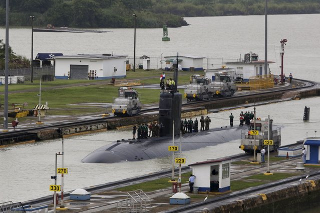 U.S. Navy submarine USS Columbus (SSN-762) with the crew on top, is seen as it sails through the Miraflores locks at the Panama Canal in Panama City July 10, 2015. (Photo by Carlos Jasso/Reuters)