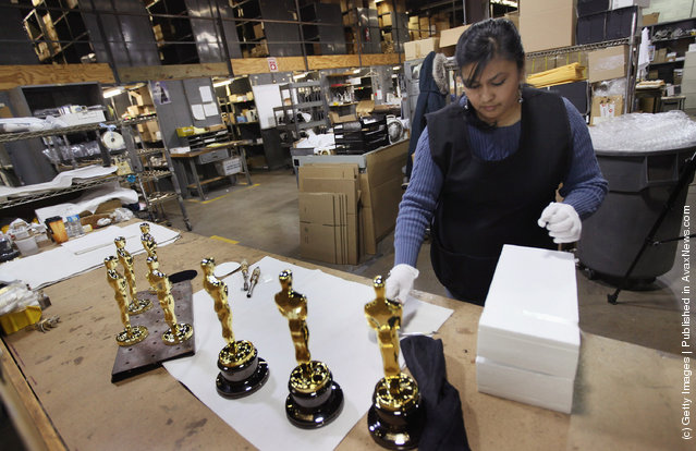 Josefina Govea packages an Oscar statuette at R.S. Owens & Company