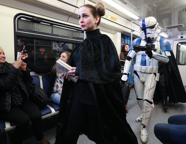 Princess Leia and a stormtrooper look for a seat in Moscow, Russia on May 4, 2017. (Photo by Vyacheslav Prokofyev/TASS)