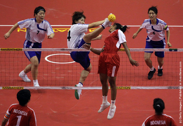 Sepaktakraw: Japan's Nohara Yamaguchi #4 returns a shot to Indonesia's Nur Qadri during day two of the ISTAF Super Series at the Palembang Sport Convention Center