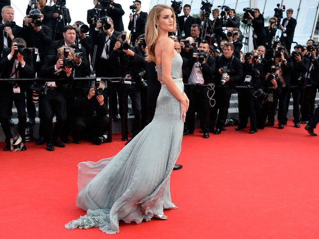 """British model Rosie Huntington Whiteley poses during a photocall the film """"The Search"""" at the 67th Cannes Film Festival in Cannes, France on May 21, 2014. (Photo by Mustafa Yalcin/Anadolu Agency/Getty Images)"""