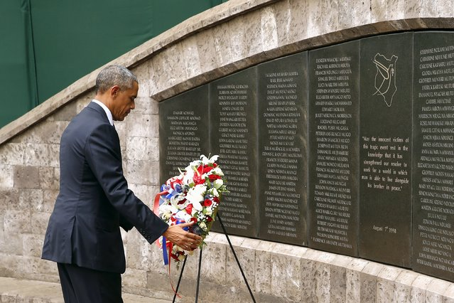 U.S. President Barack Obama lays a wreath at Memorial Park on the former site of the U.S. Embassy, where al Qaeda bombed the compound in 1998 killing more than 200 people, in Nairobi July 25, 2015. (Photo by Jonathan Ernst/Reuters)