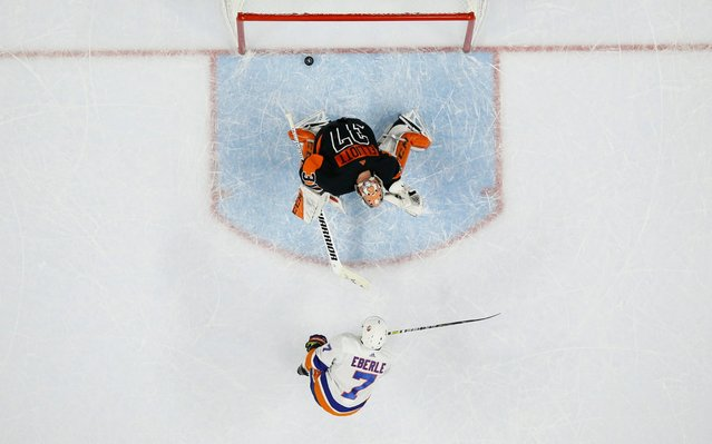 New York Islanders' Jordan Eberle (7) scores a goal past Philadelphia Flyers' Brian Elliott (37) during a shootout in an NHL hockey game, Saturday, November 16, 2019, in Philadelphia. New York won 4-3. (Photo by Matt Slocum/AP Photo)