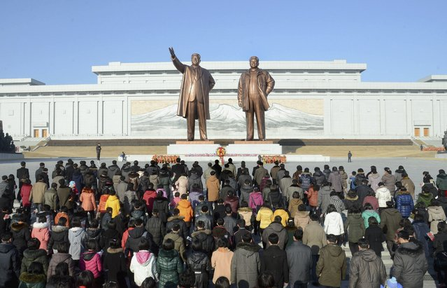 North Koreans pay their respects at the statues of former North Korean leaders Kim Il Sung (L) and Kim Jong Il on Lunar New Year in this February 19, 2015 photo released by North Korea's Korean Central News Agency (KCNA) in Pyongyang February 19, 2015. (Photo by Reuters/KCNA)