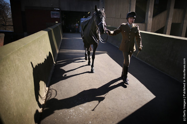 A member of The Household Cavalry Mounted Regiment (HCMR) walks his horse at Hyde Park Barracks