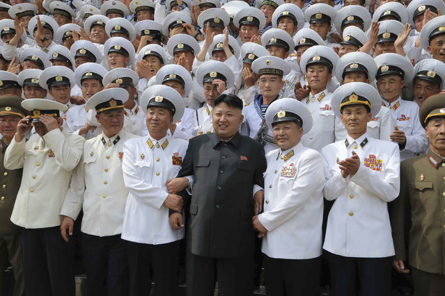 North Korean leader Kim Jong Un (C) poses with officers and sailors of Korean People's Army (KPA) Naval Unit 167 in this undated photo released by North Korea's Korean Central News Agency (KCNA) in Pyongyang June 16, 2014. (Photo by Reuters/KCNA)