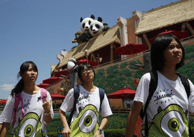 Tourists walk past giant panda avenue at Ocean Park in Hong Kong, Tuesday, July 28, 2015. (Photo by Kin Cheung/AP Photo)