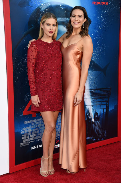"""Actors Claire Holt (L) and Mandy Moore attend the Premiere Of Dimension Films' """"47 Meters Down"""" at Regency Village Theatre on June 12, 2017 in Westwood, California. (Photo by Michael Kovac/WireImage)"""