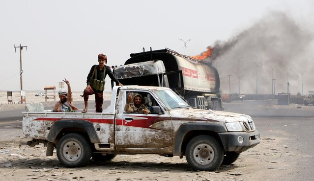 Southern separatist fighters patrol a road during clashes with government forces in Aden, Yemen August 29, 2019. (Photo by Fawaz Salman/Reuters)