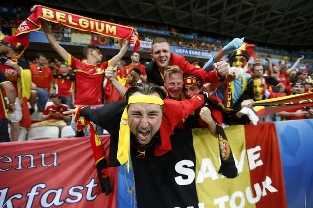 Belgium fans celebrate their 1-0 win over Sweden in the Euro 2016 group E football match between Sweden and Belgium at the Allianz Riviera stadium in Nice on June 22, 2016. (Photo by Valery Hache/AFP Photo)