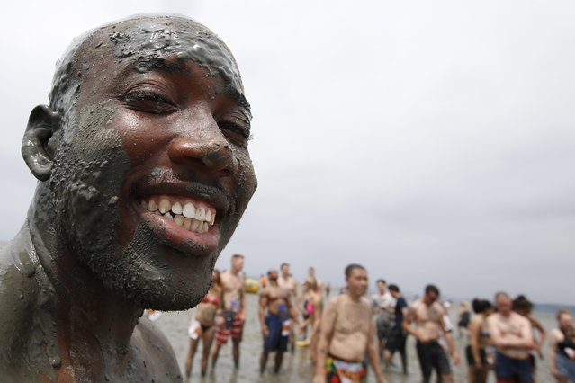 A festival-goer takes a bath in a mud flat during the 20th Boryeong Mud Festival on Daecheon beach in Boryeong City, some 190 kilometers west of Seoul, South Korea, 22 July 2017. (Photo by Jeon Heon-Kyun/EPA/EFE)