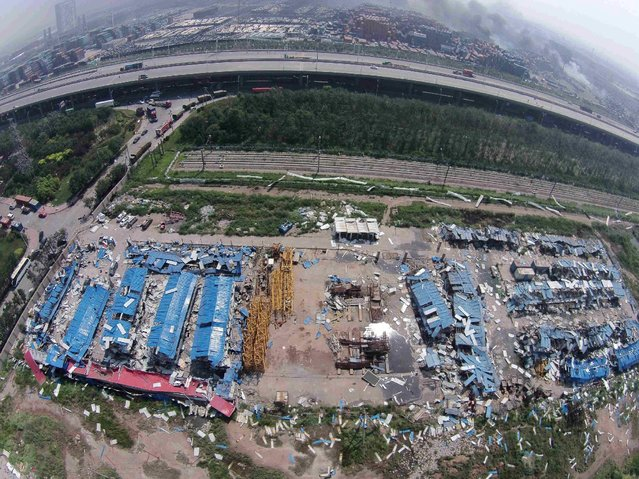 An aerial picture of shattered builders' temporary work sheds is seen near the site of the explosions at the Binhai new district, Tianjin, August 13, 2015. (Photo by Reuters/Xinhua)