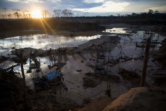 View of destroyed illegal gold mining camps after a police operation in La Pampa, in the southern Amazon region of Madre de Dios, August 11, 2015. (Photo by Sebastian Castaneda/Reuters)