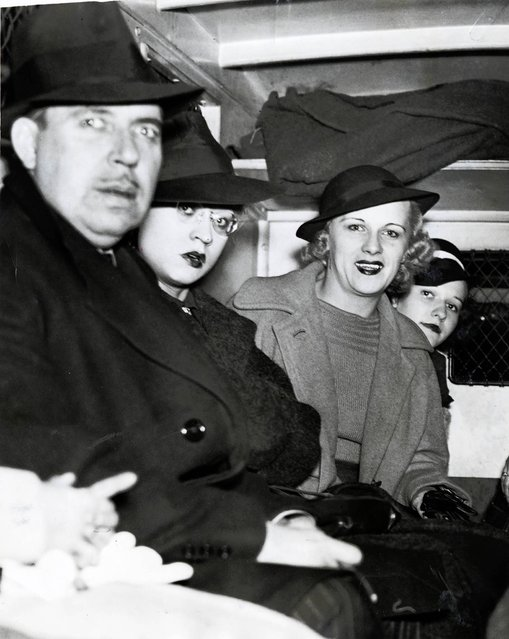 People arrested sit in back of a police wagon following a vice raid on the Rialto Theatre, October 17, 1937. Twenty-two women and 10 men were arrested in the surprise raid at the theater and charged with presenting or participating in indecent exhibitions. All arrested were released on $125 bail. In total 70 men and 45 women were arrested in the surprise raids across the city. (Photo by Chicago Tribune Historical Photo)