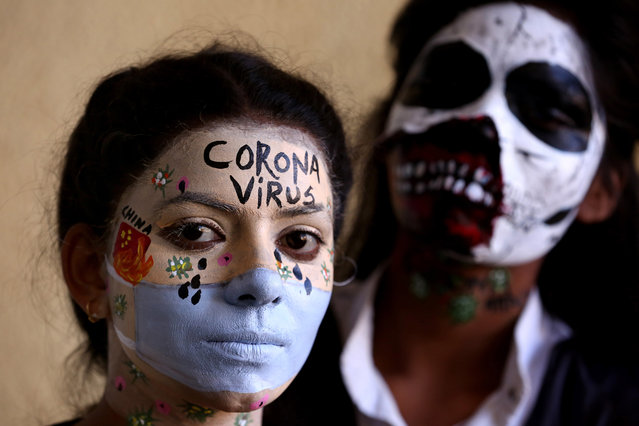 Indian students with face painted pose for a photo during an inter-college face painting competition at the Government Sardar Vallabh Bhai Patel Polytechnic College in Bhopal, India, 17 February 2020. Over fifty people participated in the event and made face paintings on various issues including the coronavirus or COVID-19. (Photo by Sanjeev Gupta/EPA/EFE)