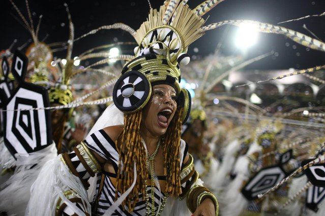 A reveller of Grande Rio samba school performs during the first night of the Carnival parade at the Sambadrome in Rio de Janeiro, Brazil on February 24, 2020. (Photo by Pilar Olivares/Reuters)