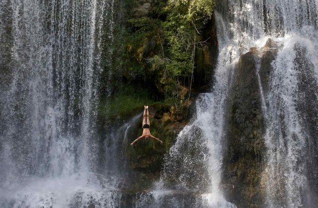 A competitor takes part in the first international waterfall jumping competition held in the old town of Jajce August 9, 2014. (Photo by Dado Ruvic/Reuters)