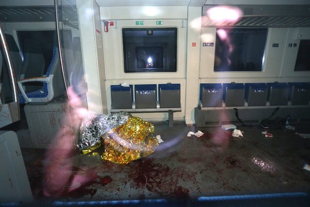Blood stains are seen on the regional train on which a man allegedly wielding an axe attacked passengers in Wuerzburg, Germany, 18 July 2016. (Photo by Karl-Josef Hildenbrand/EPA)
