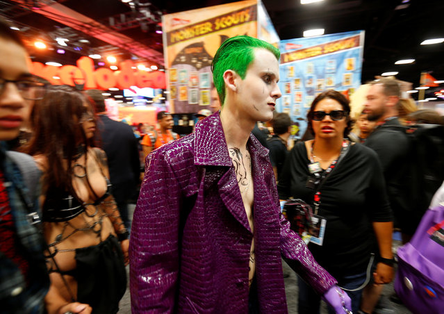 An attendee dressed as The Joker walks the convention floor in costume during opening day of Comic-Con International in San Diego, California, United States July 21, 2016. (Photo by Mike Blake/Reuters)