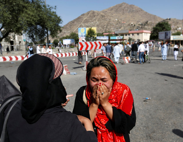 An Afghan woman weeps at the site of a suicide attack in Kabul, Afghanistan July 23, 2016. (Photo by Mohammad Ismail/Reuters)