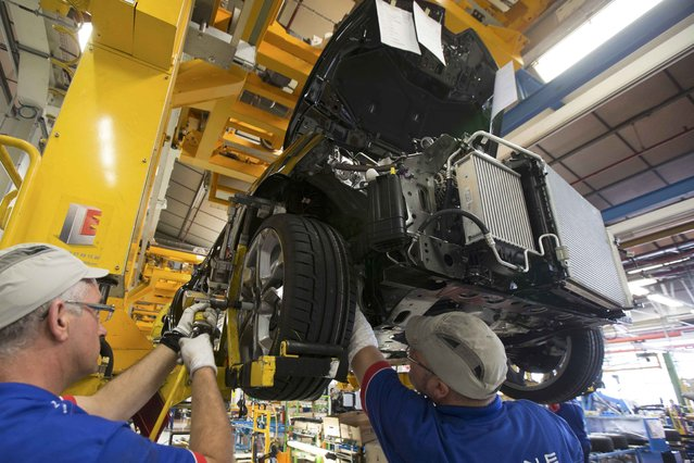 Employees of French carmaker Renault work on the Clio RS assembly line at Renault factory in Dieppe, France, September 1, 2015. (Photo by Philippe Wojazer/Reuters)